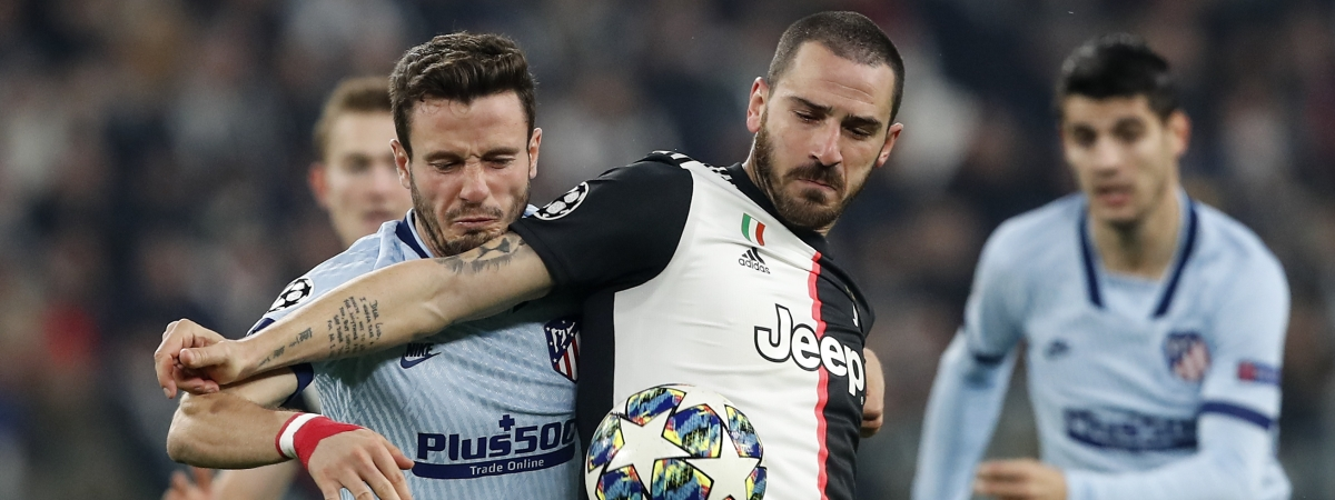 Juventus' Leonardo Bonucci, right, and Atletico Madrid's Saul Niguez challenge for the ball during the Champions League group D soccer match between Juventus and Atletico Madrid at the Allianz stadium in Turin, Italy, Tuesday, Nov. 26, 2019.