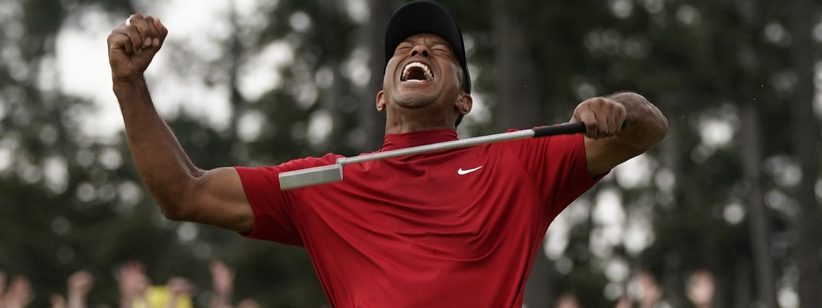 In this April 14, 2019 file photo, Tiger Woods reacts as he wins the Masters golf tournament in Augusta, Ga. Woods' victory at the Masters might not have been the most important sports story of 2019. It was certainly one of the most uplifting. Voters chose Woods' dramatic comeback at Augusta National as The Associated Press sports story of the year.