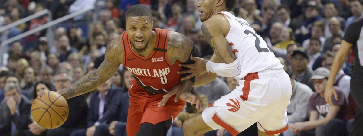 Portland Trail Blazers guard Damian Lillard (0) is defended by Toronto Raptors guard Patrick McCaw (22) during the second half of an NBA basketball game Tuesday, Jan. 7, 2020, in Toronto.
