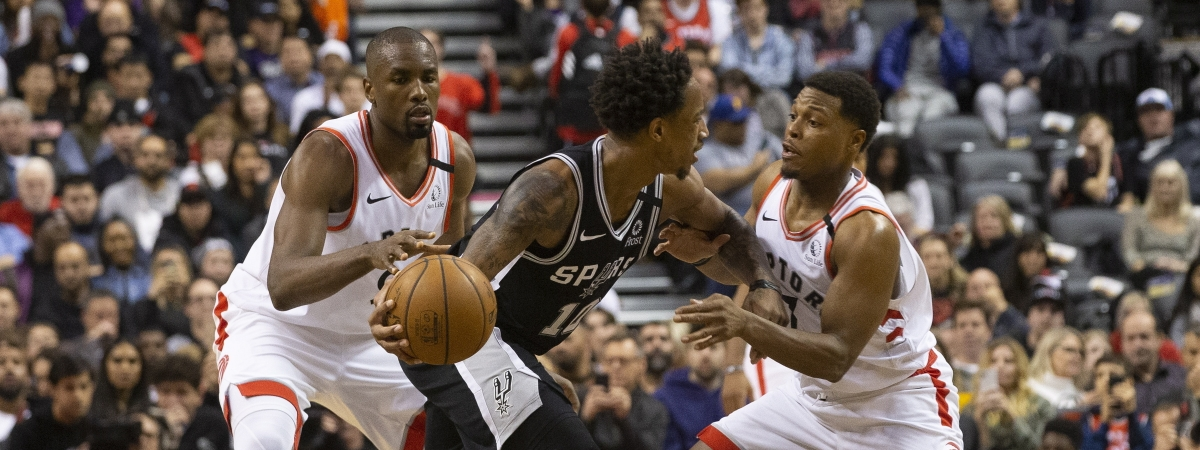 DeMar DeRozan,of the Spurs, works against Kyle Lowry and Serge Ibaka, Jan. 12 in Toronto. The rematch is today in San Antonio. (Chris Young/The Canadian Press via AP)h