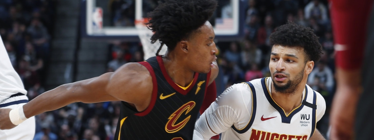Nuggets guard Jamal Murray (right) drives past Cavaliers guard Collin Sexton on Jan. 11