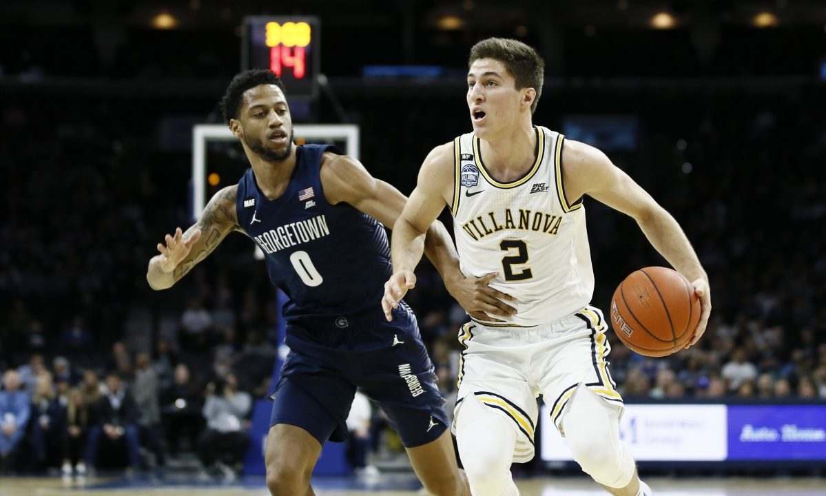 Villanova's Collin Gillespie, right, tries to dribble past Georgetown's Jahvon Blair during the first half of an NCAA college basketball game, Saturday, Jan. 11, 2020, in Philadelphia. (AP Photo/Matt Slocum)