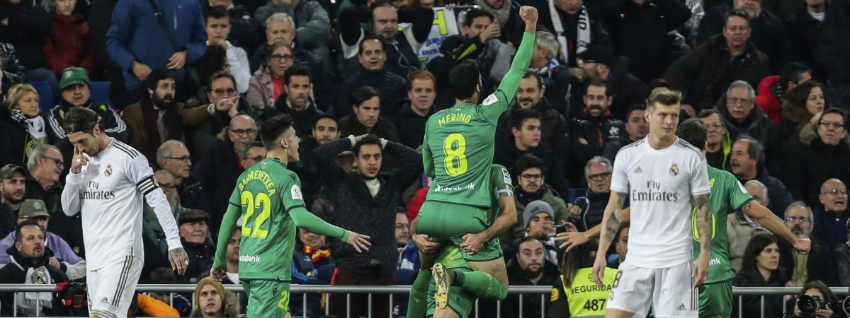 Real Sociedad players, center, celebrate after scoring the fourth goal during a Spanish Copa del Rey soccer match between Real Madrid and Real Sociedad at the Santiago Bernabeu stadium in Madrid, Spain, Thursday, Feb. 6, 2020.
