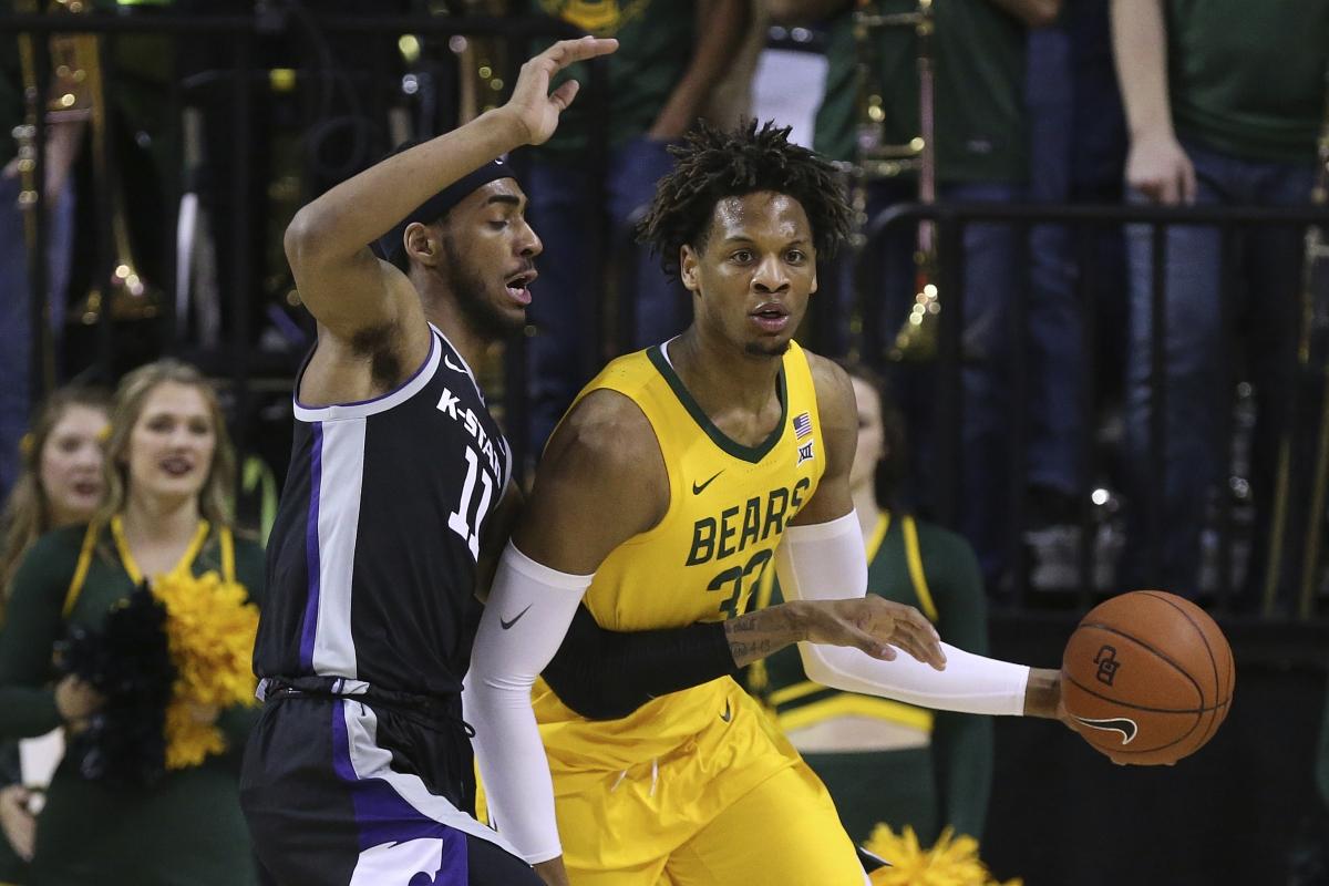 Baylor forward Freddie Gillespie (33) holds off Kansas State forward Antonio Gordon (11) in the first half of an NCAA college basketball game, Tuesday, Feb. 25, 2020, in Waco, Texas. (AP Photo/ Jerry Larson)