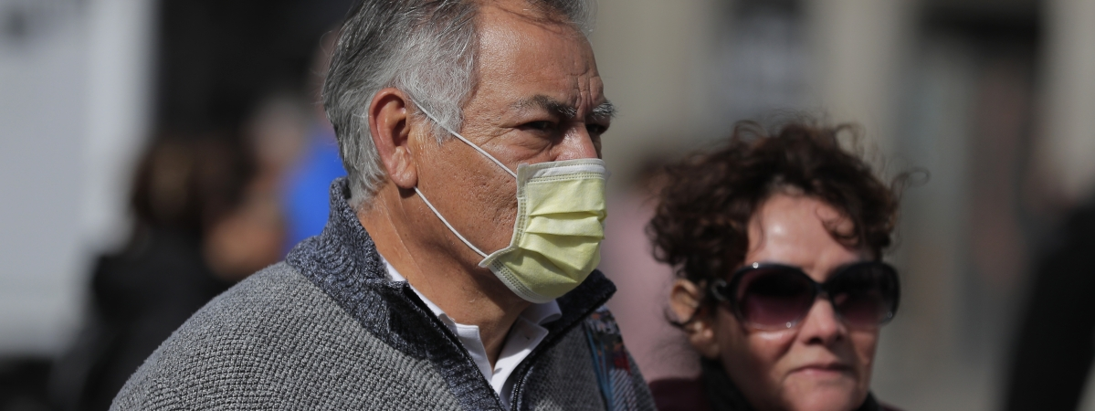 A man wears a face mask in central Madrid, Spain, Monday, March 9, 2020. Health authorities in the Madrid region say that infections for the new coronavirus have more than doubled in the past 24 hours.