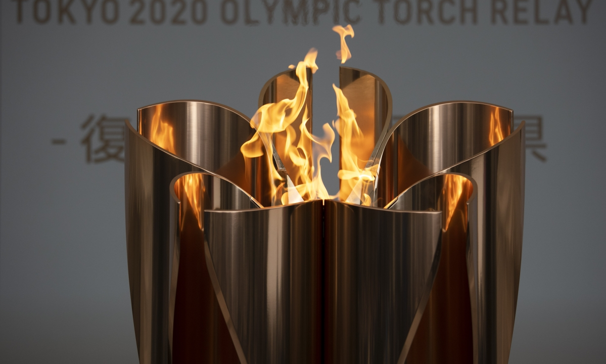 In this March 24, 2020, file photo, the Olympic Flame burns during a ceremony in Fukushima City, northern Japan. Tokyo Olympic organizers seem to be leaning away from starting the rescheduled games in the spring of 2021. More and more the signs point toward the summer of 2021. Organizing committee President Yoshiro Mori suggested there would be no major change from 2020.