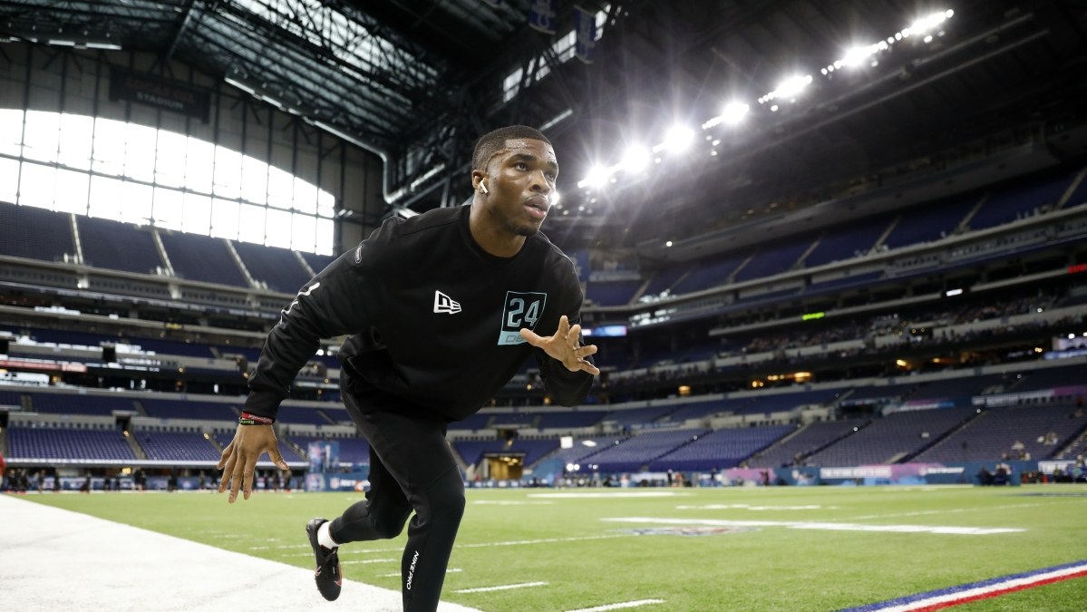 Ohio State defensive back Jeff Okudah stretches at the NFL football scouting combine in Indianapolis, Sunday, March 1, 2020.