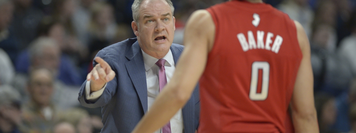 Rutgers coach Steve Pikiell gives some instructions to Geo Baker (0) during the first half of the team's NCAA college basketball game against Penn State, Wednesday, Feb. 26, 2020, in State College, Pa. (AP Photo/Gary M. Baranec)