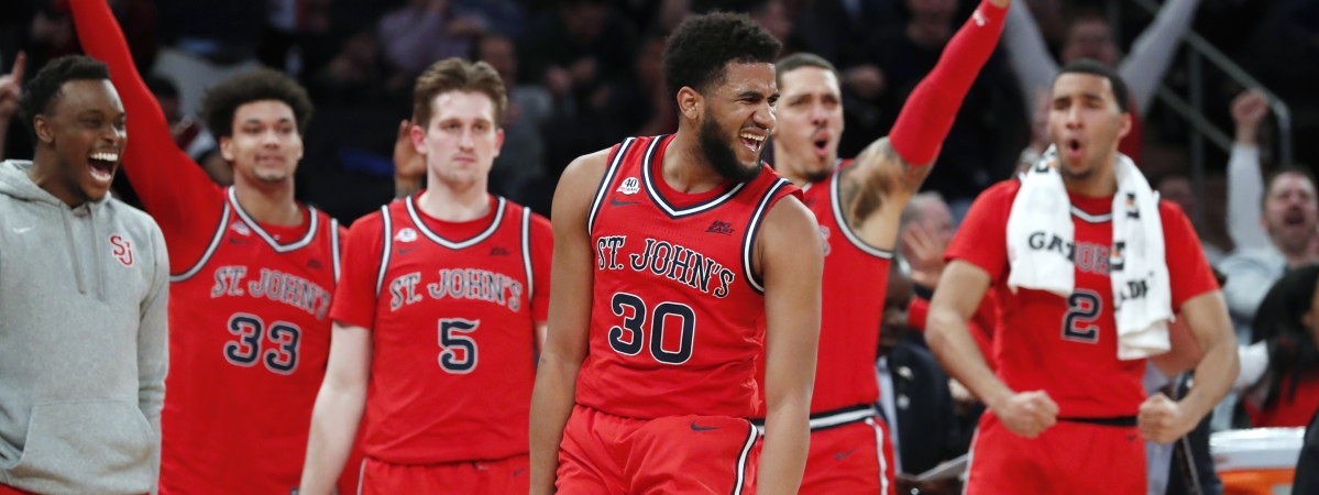 St. John's guard LJ Figueroa (30) celebrates in front of the St. John's bench after hitting a 3-pointer during the second half of the team's NCAA college basketball game against Georgetown in the first round of the Big East men's tournament Wednesday, March 11, 2020, in New York. (AP Photo/Kathy Willens)