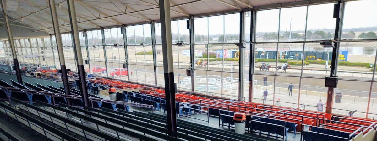 Horse Racing at Fonner Park with an empty grandstand