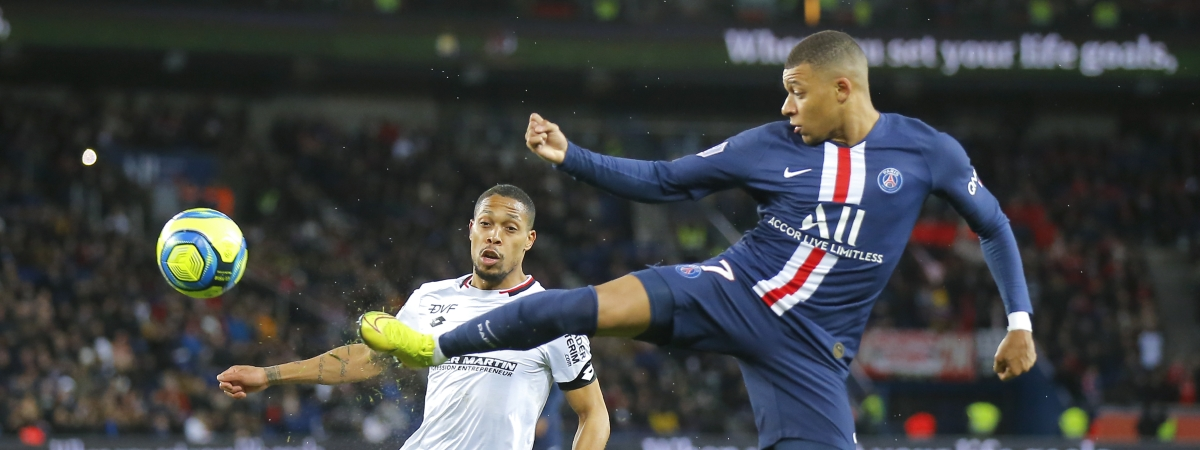 Dijon's Mickael Alphonse, left, and PSG's Kylian Mbappe challenge for the ball during the French League One soccer match between Paris-Saint-Germain and Dijon, at the Parc des Princes stadium in Paris, France, Saturday, Feb. 29, 2020.