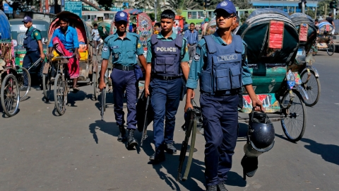 Bangladeshi policemen patrol through the streets during a nationwide strike called by the main Islamist party, Jamaat-e-Islami, in Dhaka, Bangladesh, November 23, 2015. (Photo: AP)