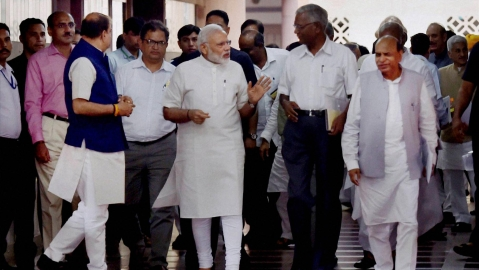 Prime Minister Narendra Modi with NCP Leader DP Tripathi and CPI leader D Raja after an all-party meeting ahead of the monsoon session, at Parliament House in New Delhi on Sunday, 17 July 2016. (Photo: PTI)