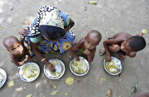 A Muslim women is feeding her children at a relief camp in Assam in August  2012. (Photo: Reuters)