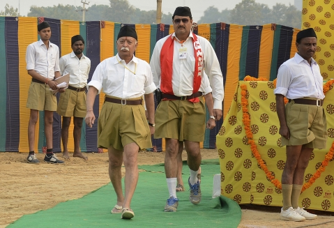 Mohan Bhagwat (3rd L), chief of Rashtriya Swayamsevak Sangh walks after addressing volunteers during a training camp in Agra in 2014. (Photo: Reuters)