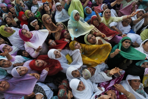 Kashmiri Muslim women raise their arms upon seeing a relic of Prophet Mohammed during Meeraj-un-Nabi celebrations at Hazratbal shrine in Srinagar. (Photo: Reuters)