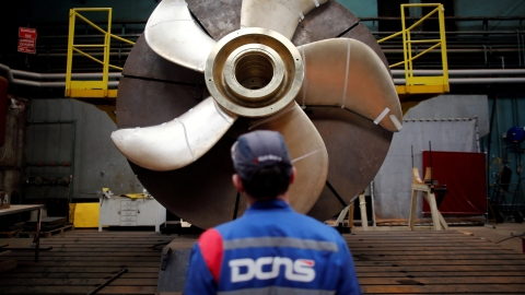 An employee looks at the propeller of a Scorpene submarine at the industrial site of the naval defence company and shipbuilder DCNS in France. (Photo: Reuters)