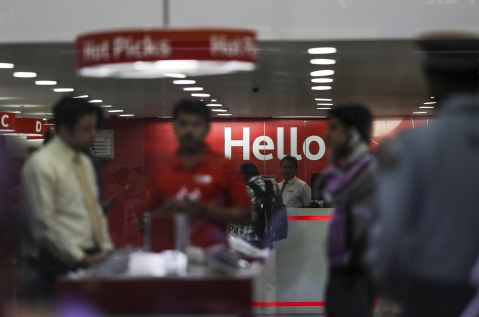 Customers stand inside a Vodafone Group Plc retail store in Mumbai, India (Photographer: Dhiraj Singh/Bloomberg)
