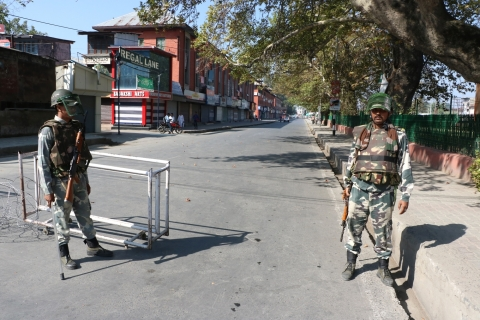 Security personnel deployed on Srinagar roads as authorities impose curfew in all ten districts of the Valley. (Photo: IANS)