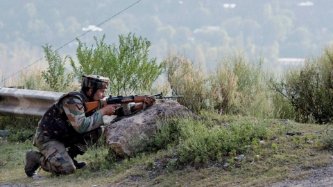 An army soldier takes position near the army brigade camp during a terror attack in Uri, Jammu and Kashmir, on Sunday. (Photo: IANS)