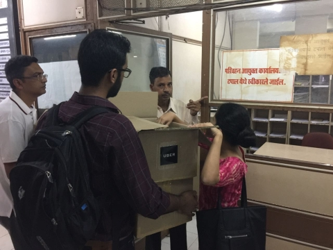 Uber employees deliver the first round of signed petitions to the Transport Commisioner's office on Friday. (Photographer: Vishal Patel)