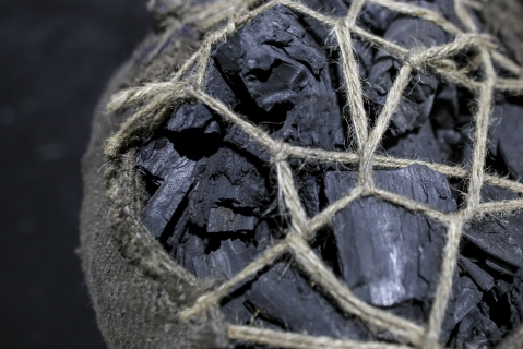 A sack of coal sits on the ground at a coal wholesale market in Mumbai, India (Photographer: Dhiraj Singh/Bloomberg)