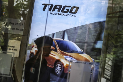 An advertisement for the Tata Motors Tiago hatchback is displayed inside the Prabhadevi Concorde Motors India Ltd. dealership in Mumbai (Photographer: Dhiraj Singh/Bloomberg)