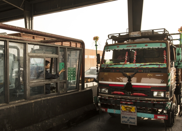 a truck stops at a toll booth at the manesar toll plaza on national highway 8 nh 8 in manesar haryana india photographer udit kulshresthabloomberg