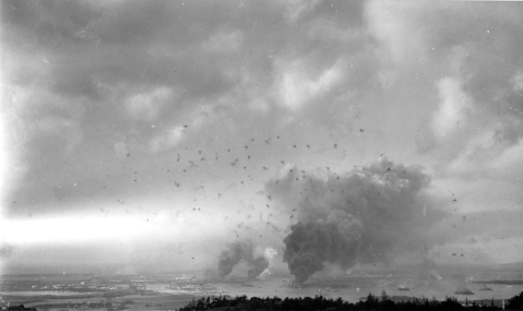 A panorama view of Pearl Harbor, during the Japanese raid on December 7, 1941, with anti-aircraft shell bursts overhead. (Image: Wikimedia Commons)