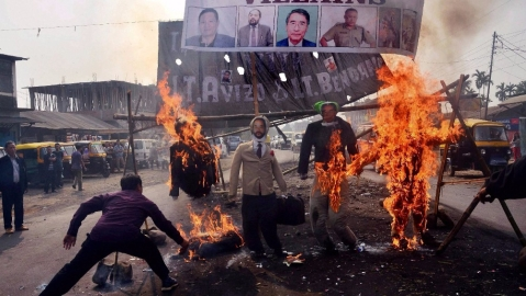 Protesters burn effigy of Nagaland Chief Minister TR Zeliang, Nagaland Home Minister Y Patton, NPF President Shürhozelie and Nagaland IRB personnel during a protest against killing of two youth by security personnel, in Dimapur, Nagaland. (Photo: PTI)
