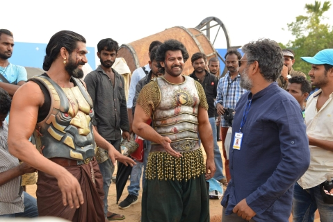 Baahubali actors Prabhas and Rana Daggubati discuss a scene with director S. S. Rajamouli. (Image source: Baahubali Facebook Page)