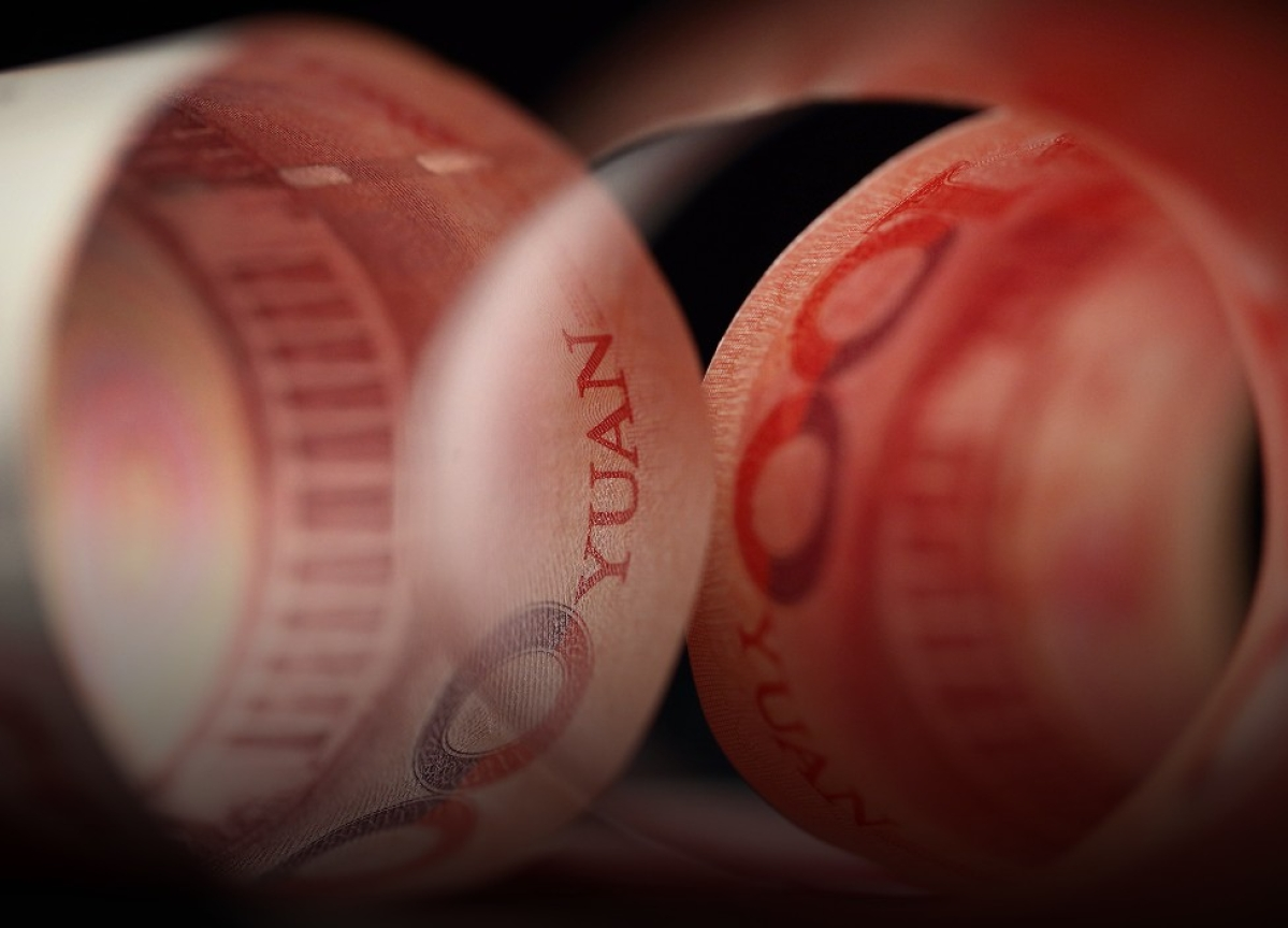 China's Yuan Weakens After PBOC Sets Fixing Closer to 7 a Dollar