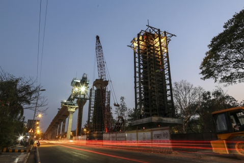 Construction of an elevated metro railway line in Nagpur. (Photographer: Dhiraj Singh/Bloomberg)