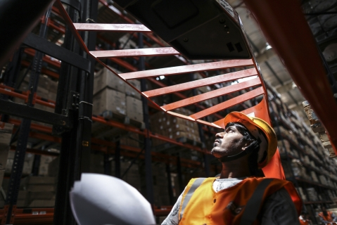 Forklift operator at the Future Group warehouse. (Photographer: Dhiraj Singh/Bloomberg)