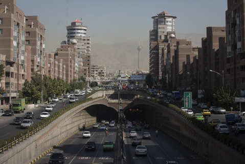 Road traffic fills a highway and underpass in present-day Tehran, Iran. (Photographer: Simon Dawson/Bloomberg)