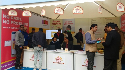 "People registering for Aadhaar at IDFC Bank's stall at the Government of Maharashtra's Digi Dhan Mela. (Photograph: <a href=""https://uidai.gov.in/media-center/media/media.html"">UIDAI website</a> Photo Gallery)"