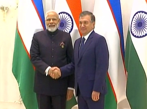PM Modi with Uzbekistan President Shavkat Mirziyoyev. (Photo Courtesy: ANI Screenshot)