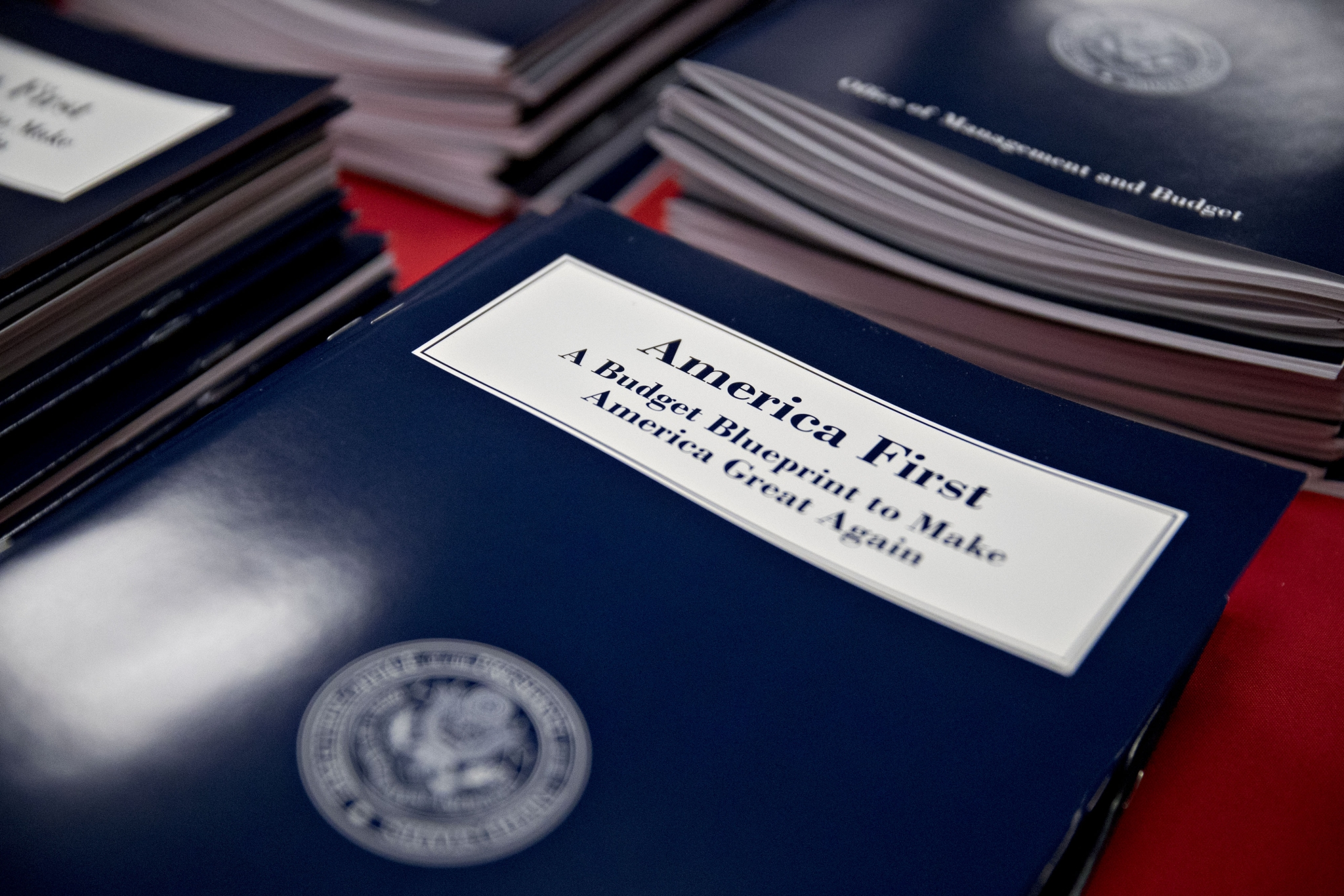 Five things modi should bring up with trump bloomberg quint copies of us president donald trumps fiscal 2018 budget request sit on display for sale in malvernweather Images