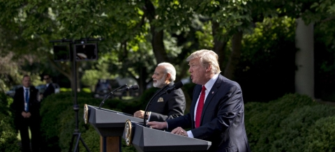 U.S. President Donald Trump, right, speaks as Narendra Modi, India's prime minister, listens during a joint statement in the Rose Garden of the White House in Washington, D.C., on June 26, 2017. (Photographer: Andrew Harrer/Bloomberg)