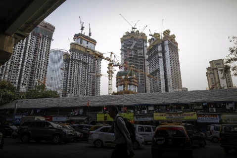 Cranes rise above the construction site of Lodha The Park, a luxury residential project developed by Lodha Developers Ltd., in Mumbai. Photographer: Dhiraj Singh/Bloomberg