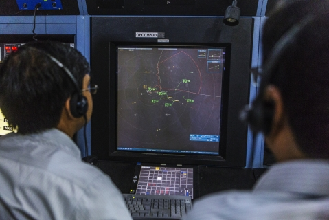 Air-traffic controllers monitors flights inside a control center at Indira Gandhi International Airport  in Delhi, India. (Photographer: Prashanth Vishwanathan/Bloomberg)