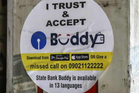A sign for mobile digital payment app State Bank Buddy, operated by State Bank of India (Photographer: Dhiraj Singh/Bloomberg)