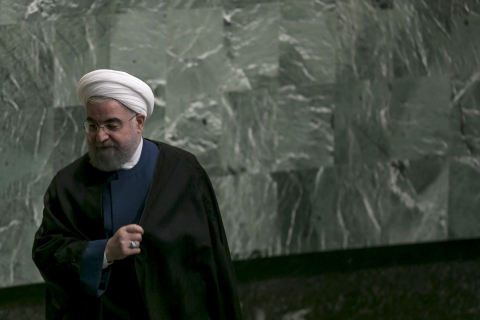 Hassan Rouhani, Iran's president, exits the podium after speaking during the UN General Assembly meeting in New York. (Photographer: Caitlin Ochs/Bloomberg)