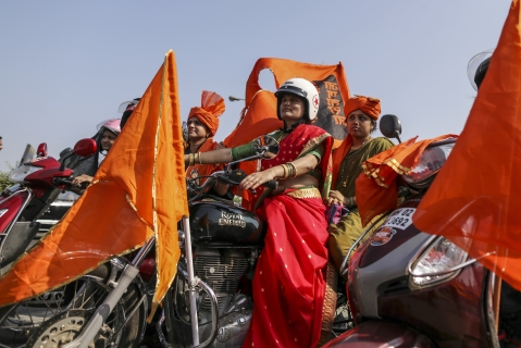Demonstrators with saffron flags ride motorcycles during a silent protest organized by Marathas. (Photographer: Dhiraj Singh/Bloomberg)