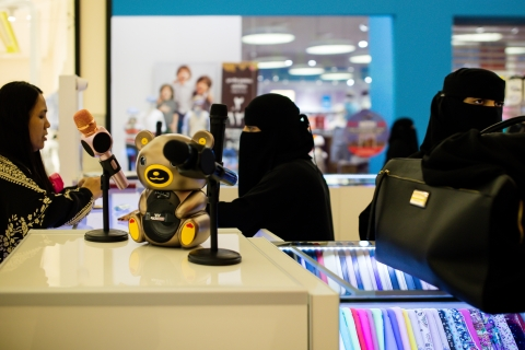 Saudi women sell products from a stall at the Al Yasmin mall in Jeddah, Saudi Arabia, on August 6, 2017. (Photographer: Tasneem Alsultan/Bloomberg)