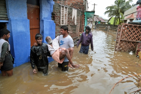 An elderly person is carried to safe place in a flooded locality following a heavy storm at Nagercoil in Kanyakumari district on Thursday. (Source: PTI)