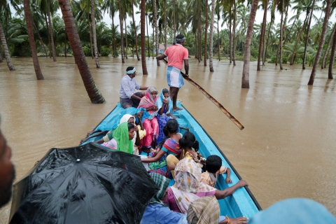 Rescuers carry out relief work in a flooded locality after heavy rains at Suchindram in Kanyakumari district on Friday. (Source: PTI)