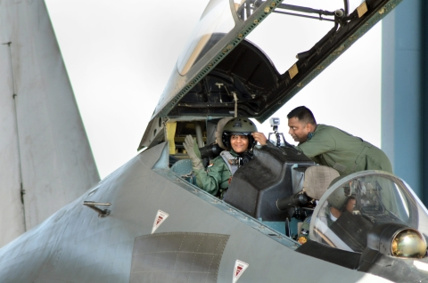 Defence Minister Nirmala Sitharaman waves from the cock-pit of IAFs Sukhoi-30 MKI plane before taking off for a sortie, in Jodhpur. (Image: PTI)