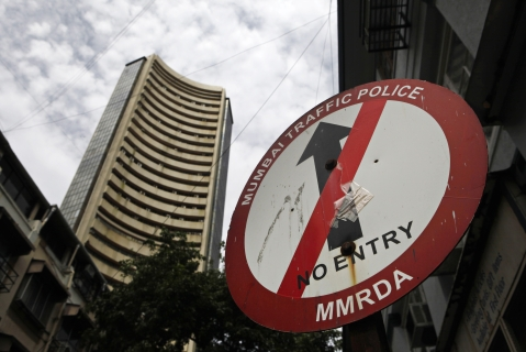 The Bombay Stock Exchange (BSE) building, left, looms over a no-entry street sign in Mumbai. (Photographer: Prashanth Vishwanathan/Bloomberg)