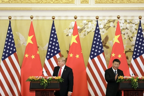 U.S. President Donald Trump, left, and Xi Jinping, China's president, attend a news conference at the Great Hall of the People in Beijing, China, on  Nov. 9, 2017. (Photographer: Qilai Shen/Bloomberg)